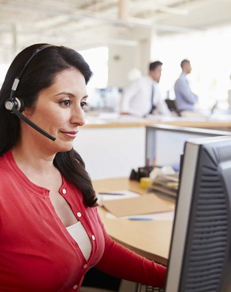 Hispanic woman working in a call centre